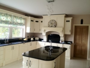 Painted ivory kitchen /black granite worktops